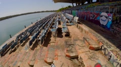 Miami Marine Stadium, flying low and fast over seating Stock Footage