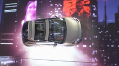 SUV hatchback Opel Adam Rocks rotates on a wall with the display Stock Footage