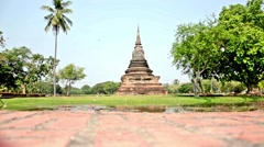 Low Shot of a Pagoda at the Ruins of Sukhothai - Slowed by 50% - stock footage