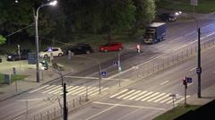 Long exposure timelapse of vehicles driving through the pedestrian crosswalk - stock footage
