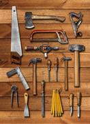 Old carpenter hand tools on wood Stock Illustration