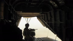 Helicopter Rear Door Gunner Stands and Aims at Target  (HD) Stock Footage