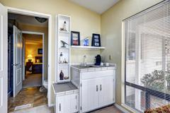 Sun room corner with cabinets and shelves Stock Photos