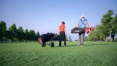 Golfers on golf course Stock Footage