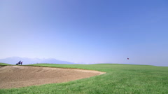 Golfers on golf course - wide shot Stock Footage