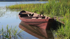 Summer's lake scenery with old wooden boat Stock Footage