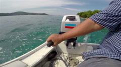Fisherman's hand navigating the wooden fishing boat Stock Footage
