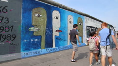 Teenager tourists at the East side gallery, Berlin - stock footage