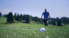 Golfer approaching the ball Stock Footage