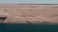 Egypt the Suez Canal 018 pipes in the sand, wide view into desert Stock Footage