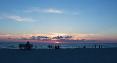 4K Beachgoers enjoy stunning FL sunset timelapse Stock Footage