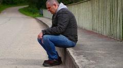 Depressed man  on the bridge Stock Footage