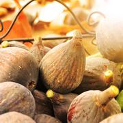 figs in a basket lit by the noon light - stock photo