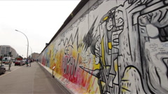 Timelapse walking along the East Side Gallery at Berlin Wall  - stock footage