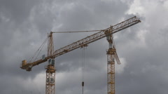 Crane machine work cloudy sky industrial structure urban construction site day  Stock Footage