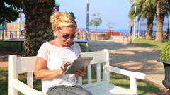 Woman with digital tablet outdoor Stock Footage