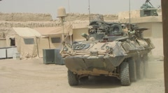 Eight Wheel Drive Stryker Military Vehicle  in WAR Stock Footage
