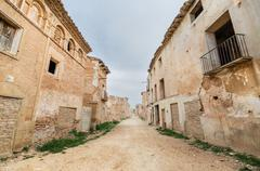 Main street in the abandoned town of belchite. Stock Photos