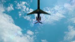 Airliner Flying Overhead with Sun Flares and Blue Sky - stock footage