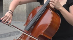 Closeup woman play violoncello instrument street artist music downtown city day - stock footage