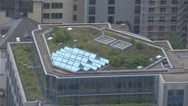 Stock Video Footage of Aerial view solar panel roof skyscraper residential building metropolis city day