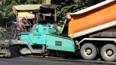 Roadworks. Machine for asphalt. Paving. Asphalting. Worker control operation. - stock footage