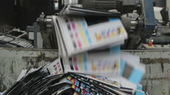Testing leaflets on the production line thrown in a garbage bin Stock Footage