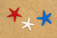 Stock Photo of patriotic starfish on beach