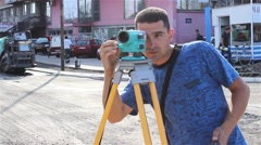 Surveyor on construction site measuring with modern survey equipment. Close up. Stock Footage