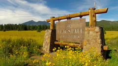 Flagstaff Arizona Sign With Humphreys Peak Behind- Wide Stock Footage