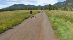 POV Bike Riding Past Dog Walkers- Buffalo Park- Flagstaff AZ Stock Footage