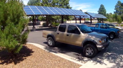 Solar Panels In Parking Lot Providing Power And Shade Stock Footage