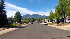 Suburban Street With Mountains Background- Flagstaff, AZ Stock Footage