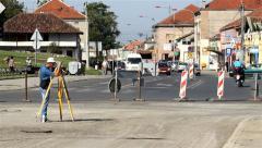 Land surveyor on construction site measuring with modern survey equipment. Stock Footage