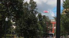 Hood Blimp Above Trees in Boston Stock Footage