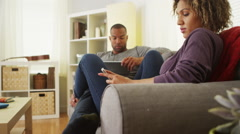 Stock Video Footage of Black couple using electronic devices on sofa