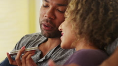 African couple talking on smartphone Stock Footage