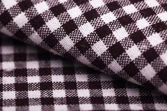 Stock Photo of table cloth with brown grid