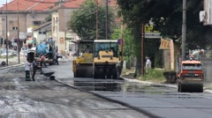 Roadworks. Paving. Road rollers flattens asphalt. Workers filling the hole. - stock footage