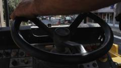 Roadwork. Steamroller. View from the road roller. Hand controls wheel. Workers. Stock Footage