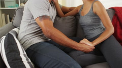 Affectionate african couple talking on couch - stock footage