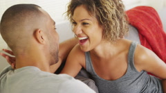 Happy couple talking on couch - stock footage