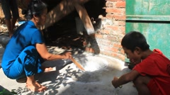 Farmers pounding rice into flour, Asia Stock Footage