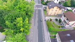 Aerial following group of cyclists on street Stock Footage