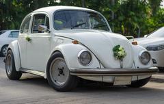 white retro car decoreted with flower - stock photo