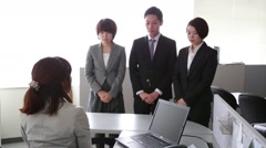 Japanese new employees being told off by their boss in the office Stock Footage