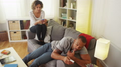Black couple distracted by smartphones Stock Footage