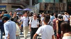 People walking at zebra crossing in Omotesando, Tokyo, Japan Stock Footage