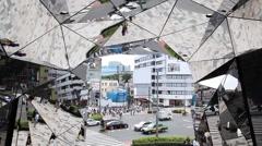 Reflections on Tokyu Plaza Omotesando Harajuku wall of mirrors entrance, Tokyo, Stock Footage