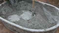labor mixing concrete for construction job - stock footage